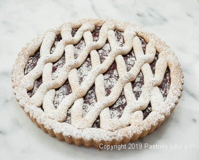 Cranberry Linzer Tart with powdered sugar