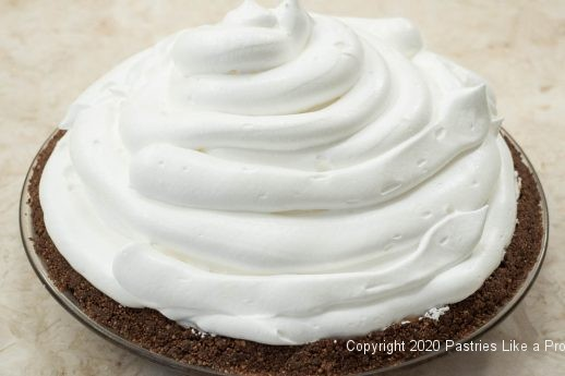 Meringue piped on for Sky High Chocolate Pie