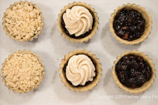 Pastry shells filled and topped for Mincemeat Tarts