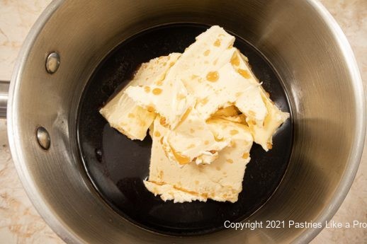 Guinness and butter in pan